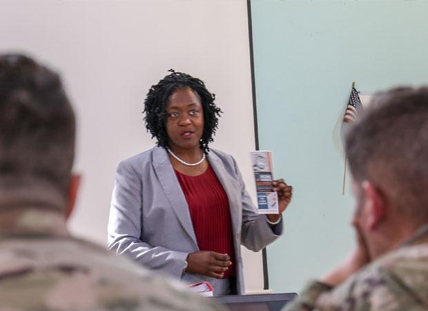 Woman veteran addressing room of military