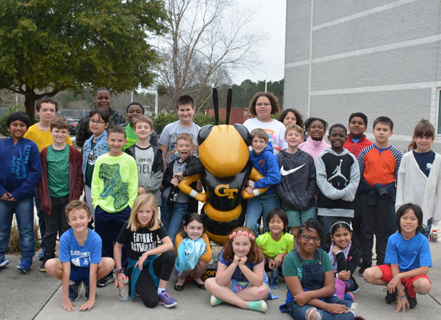 K12 program summer camp posing with Buzz