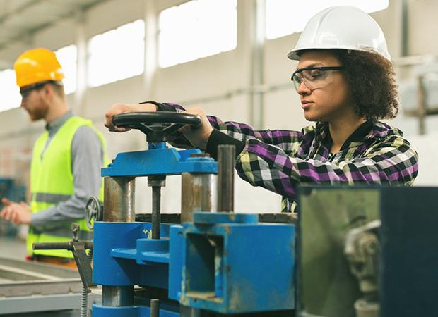 OSHA professional working on factory line floor