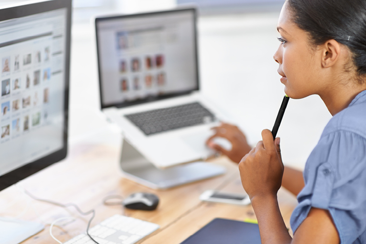 Marketing professional working with desktop