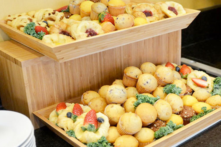 Display of freshly baked muffins and danishes