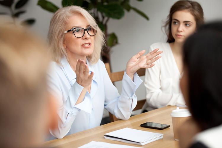 Leadership professional leading a meeting