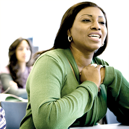 Female adult learner speaking in the classroom