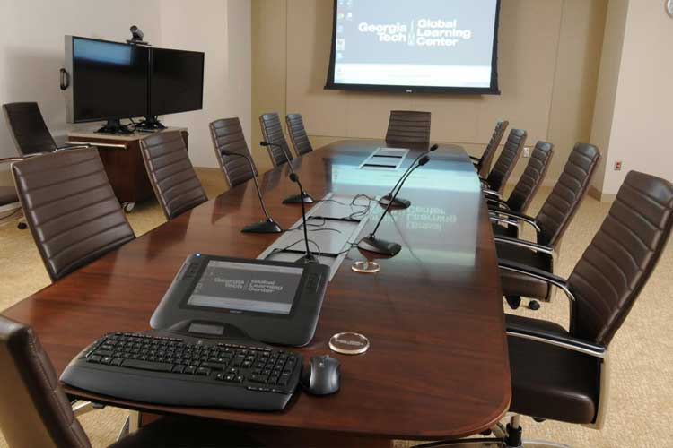 Conference table and projection screen in the video conference room