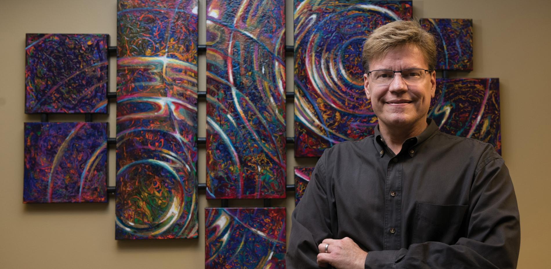 Bobby Strickland in front of painting