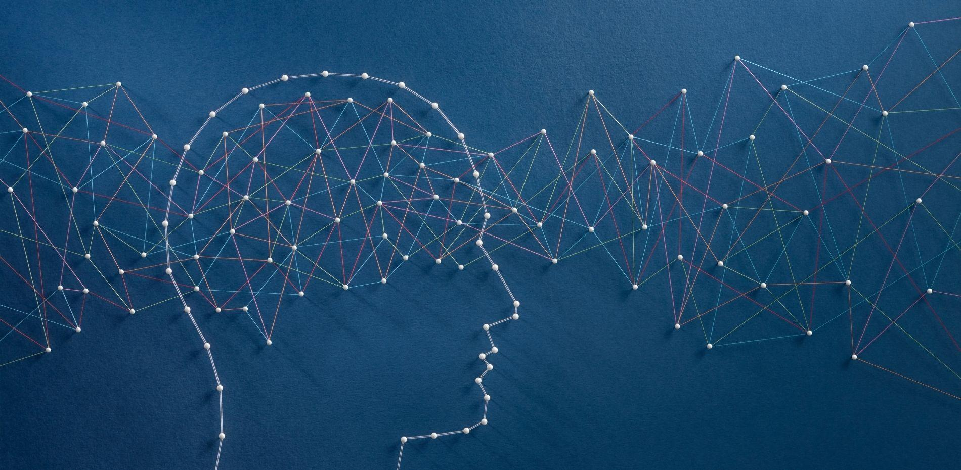 Network of pins and threads in shape of knowledge stream through mind.
